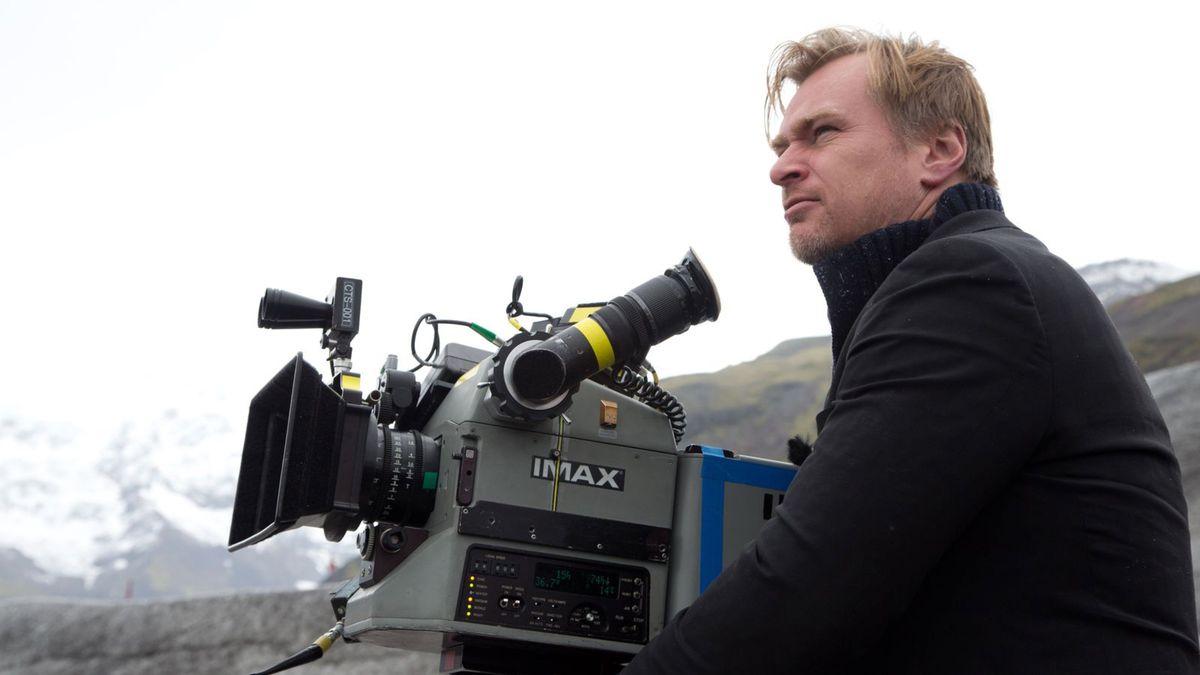 Dunkirk director Christopher Nolan with an IMAX camera.