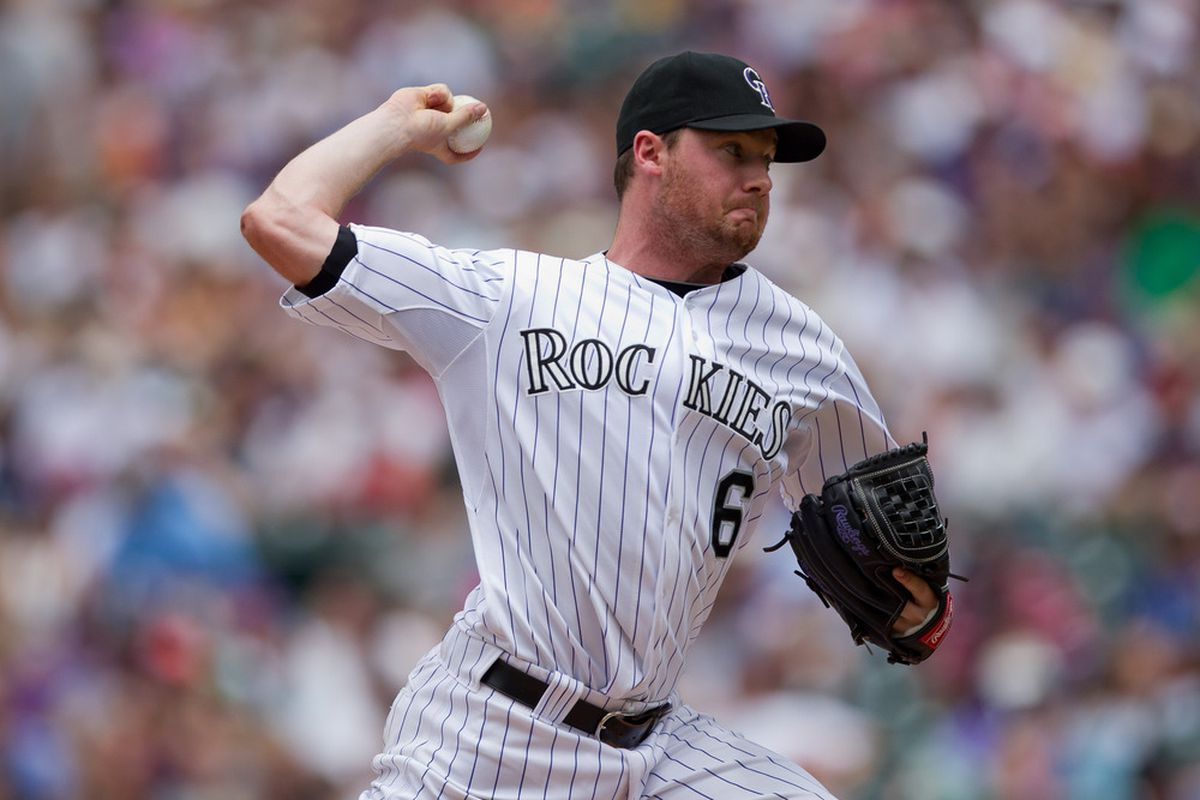 DENVER, CO - JUNE 3:  Starting pitcher Alex White #6 of the Colorado Rockies delivers to home plate against the Los Angeles Dodgers at Coors Field on June 3, 2012 in Denver, Colorado.  (Photo by Justin Edmonds/Getty Images)