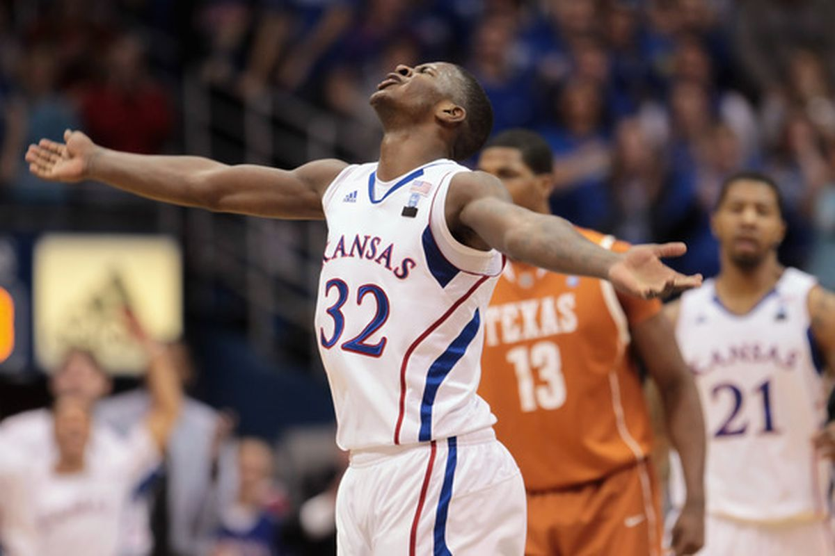 LAWRENCE KS - JANUARY 22:  Josh Selby #32 of the Kansas Jayhawks reacts after scoring during the game against the Texas Longhorns on January 22 2011 at Allen Fieldhouse in Lawrence Kansas.  (Photo by Jamie Squire/Getty Images)