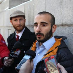 Derek Kitchen, left, and his partner Moudi Sbeity, right, talk with the media outside Frank E. Moss United States Courthouse following court on Wednesday, Dec. 4, 2013, in Salt Lake City. A challenge to Utah's same-sex marriage ban by three gay couples was back in court Wednesday as a federal court judge heard arguments in a case. Kitchen and Sbeity are plaintiff's in this case.