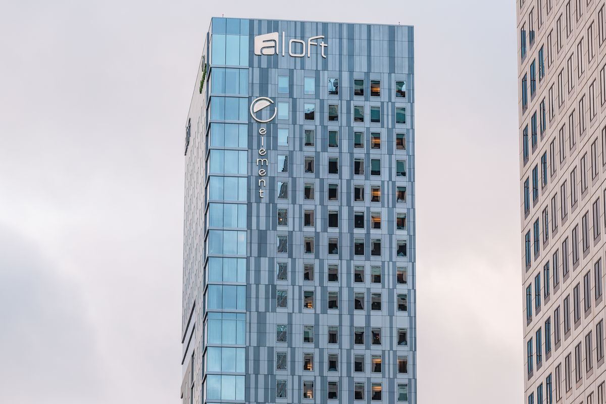 Top of a glass high-rise with words Aloft and Element on them