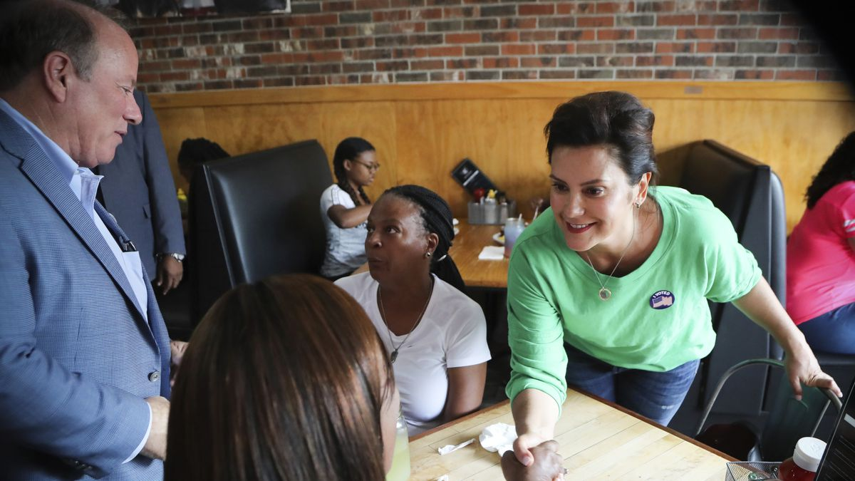 Michigan Democratic gubernatorial candidate Gretchen Whitmer and Detroit Mayor Mike Duggan visit with patrons at a restaurant in Detroit, Michigan, on August 7, 2018
