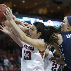 Gonzaga Bulldogs guard Lindsay Sherbert (33) and Brigham Young Cougars guard Ashley Garfield (3) fight for a rebound during the West Coast Conference championship game in Las Vegas Tuesday, March 11, 2014. BYU lost 71-57.