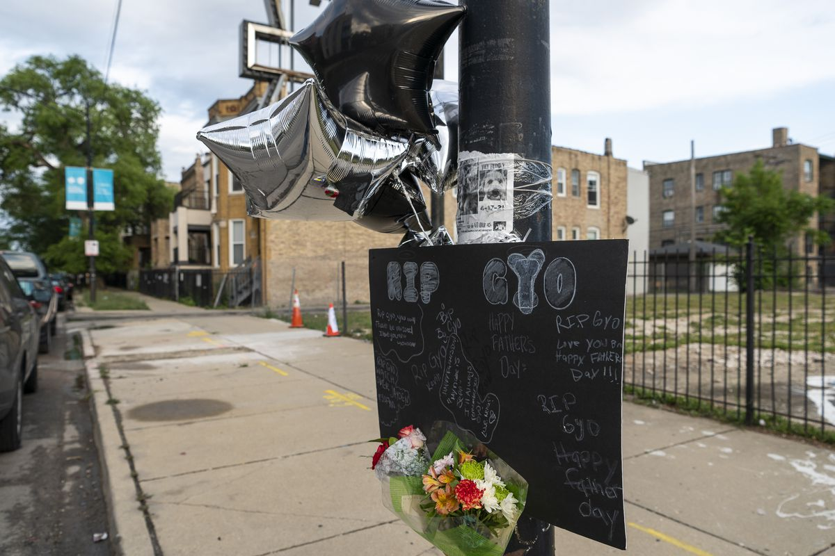 A memorial was set up for Gyovanny Arzuaga, who was shot and killed in the 3200 block of West Division Street Saturday night while celebrating Puerto Rican Day. His girlfriend, and mother of their two children, was shot and critically wounded. | Tyler LaRiviere/Sun-Times