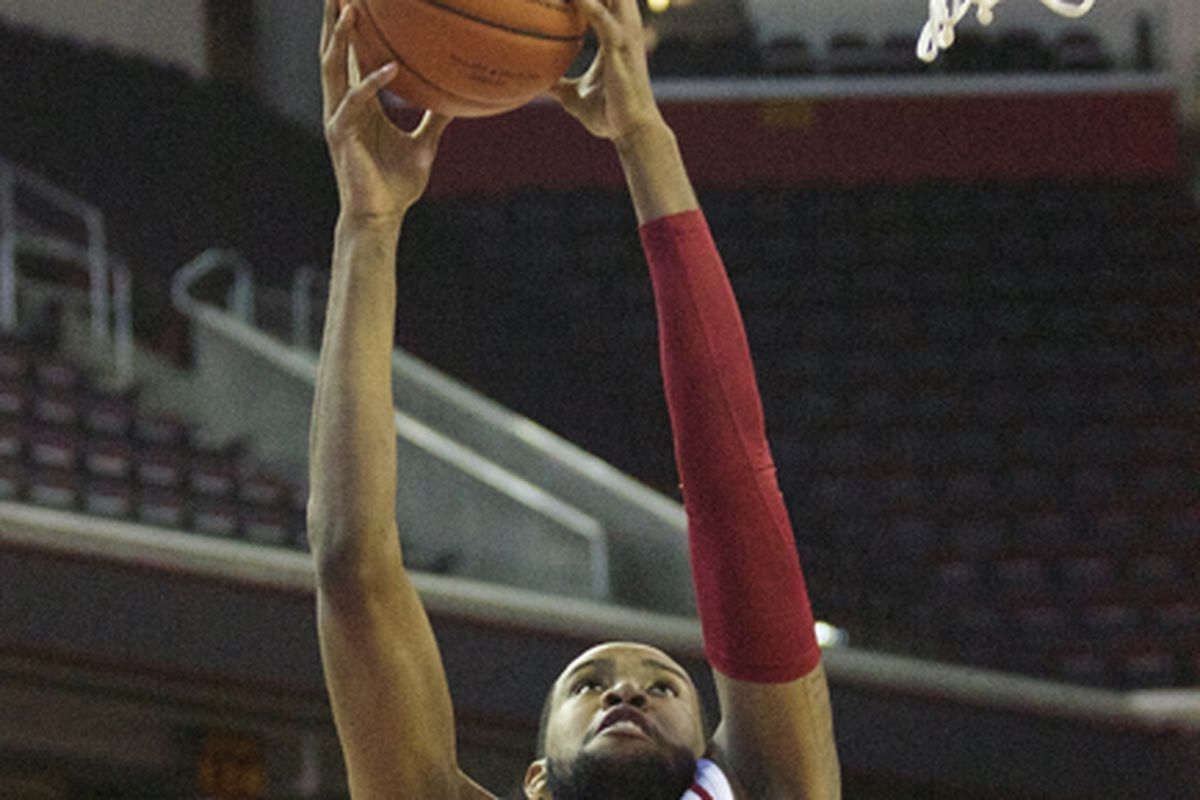 Malik Martin goes up for a dunk.