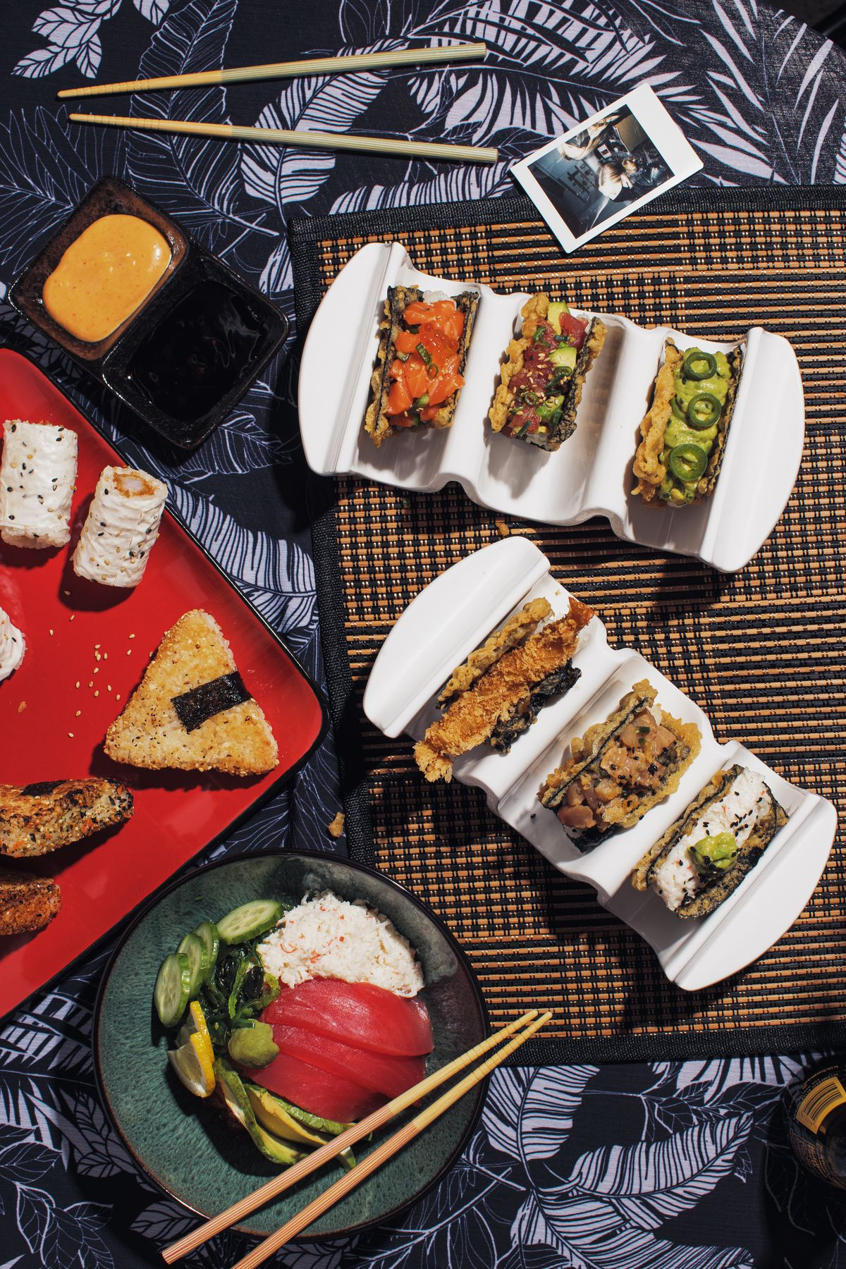 Table with sushi, nori rolls and other snacks from Kumi