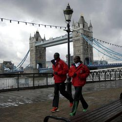 The winners of the 2011 men's and women's London Marathon races Kenya's Emmanuel Mutai, left, and Mary Keitany pose for photographers during a media event by Tower Bridge in London, Tuesday, April 17, 2012. The 2012 London Marathon takes place on Sunday.