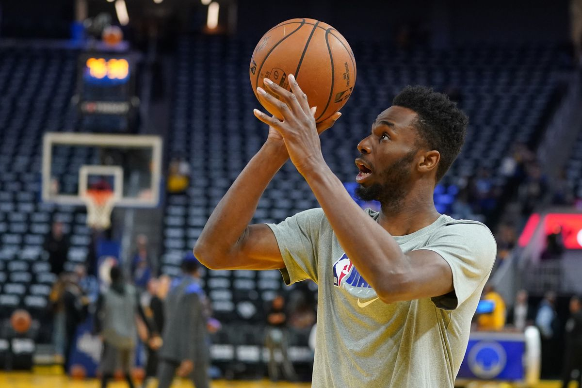 Golden State Warriors guard Andrew Wiggins warms up before the game against the Los Angeles Lakers at Chase Center.