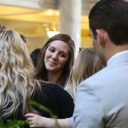 Hannah Lockhart, daughter of former Speaker of the House Rebecca Lockhart, is greeted by family at the beginning of a public memorial service for Lockhart in the Capitol rotunda in Salt Lake City on Thursday, Jan. 22, 2015. Lockhart died at her home in Provo on Jan. 17, 2015, from a rare brain disease.