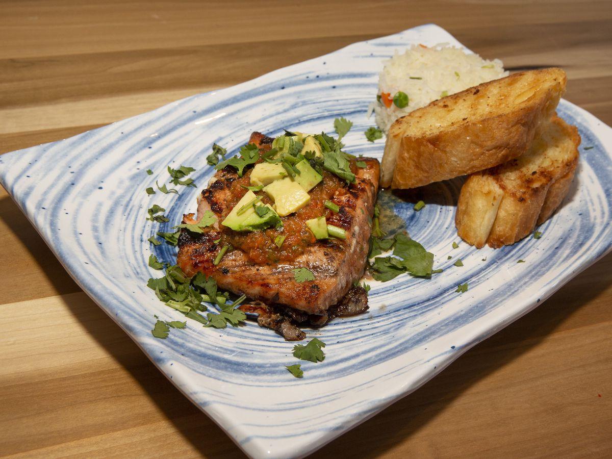Salmon a la Parilla (Atlantic Salmon, tequila honey glaze, fire-roasted salsa with avocado)