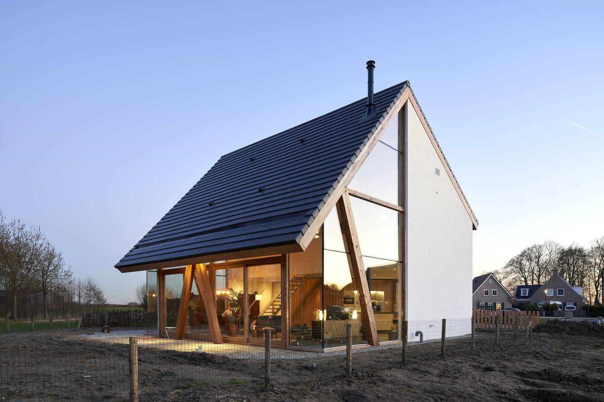 Barn-shaped house at twilight