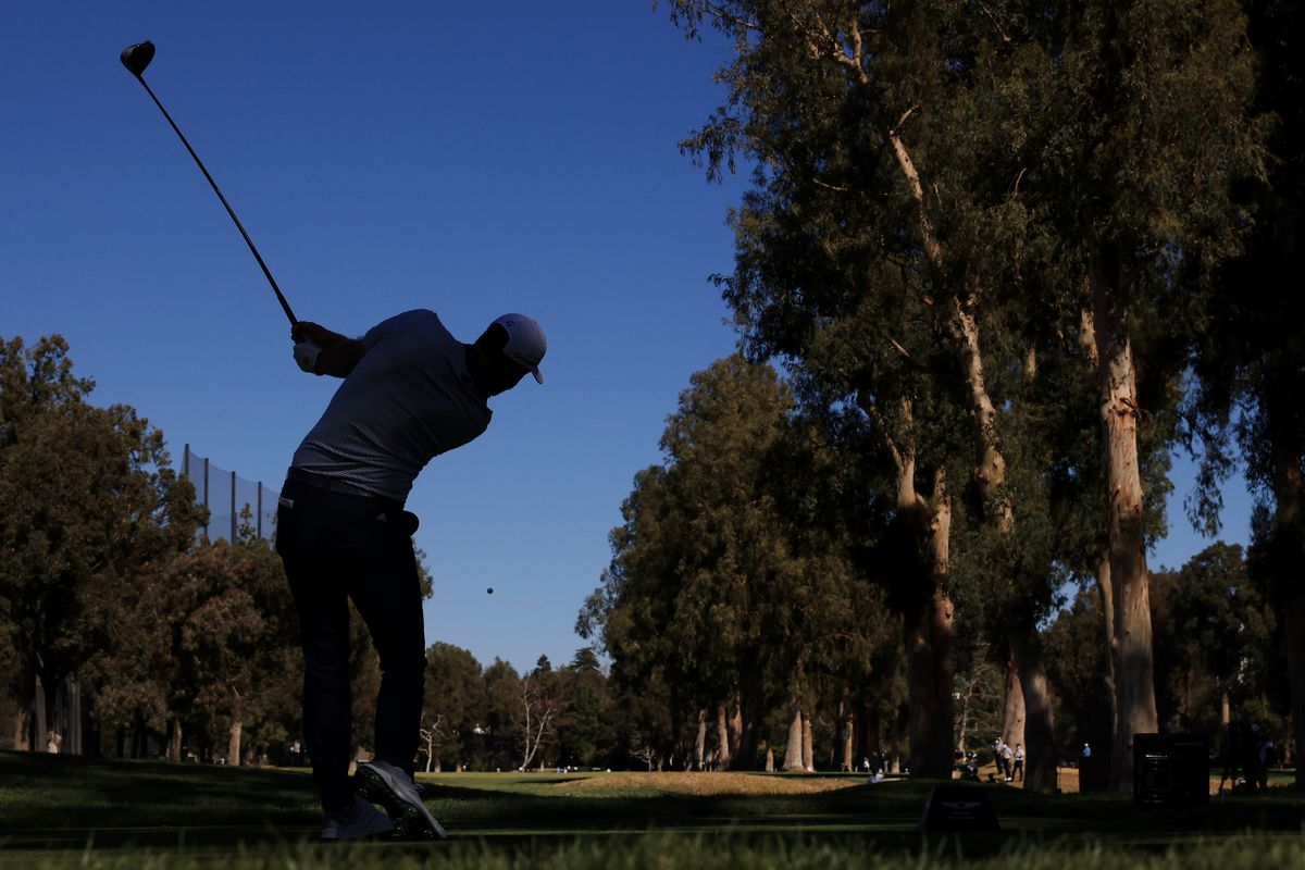 Dustin Johnson of the United States plays his shot from the 11th tee during the final round of The Genesis Invitational at Riviera Country Club on February 21, 2021 in Pacific Palisades, California.
