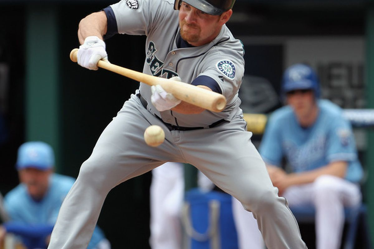 KANSAS CITY, MO - APRIL 17:  Ryan Langerhans #12 of the Seattle Mariners lays down a bunt during the game against the Kansas City Royals on April 17, 2011 at Kauffman Stadium in Kansas City, Missouri.  (Photo by Jamie Squire/Getty Images)
