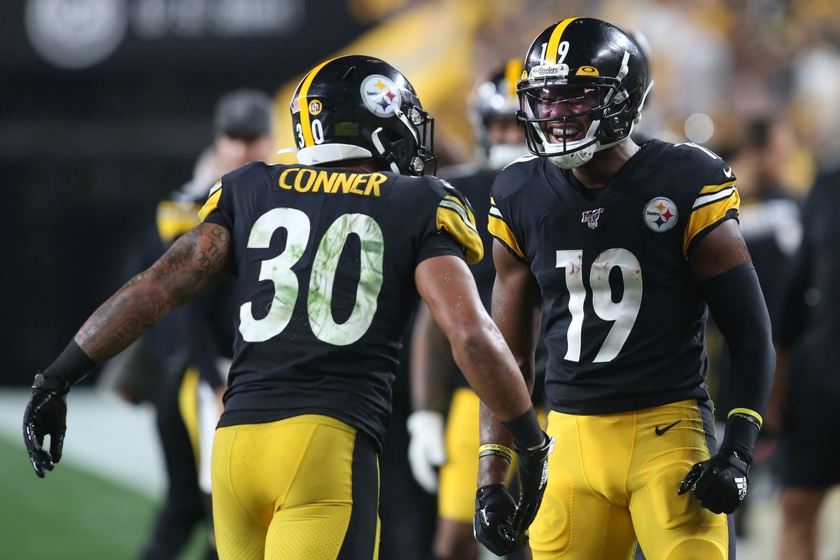 Pittsburgh Steelers running back James Conner and wide receiver JuJu Smith-Schuster celebrate a Steelers touchdown against the Cincinnati Bengals during the third quarter at Heinz Field.