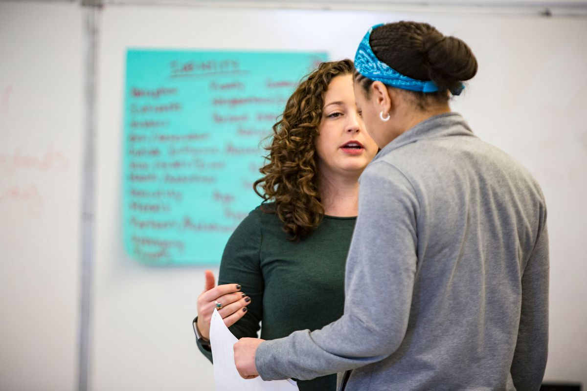TimeLine Theatre's Teaching Artist Lexi Saunders with Alcott College Prep. Freshman Auriel Williams   James Foster/For the Sun-Times