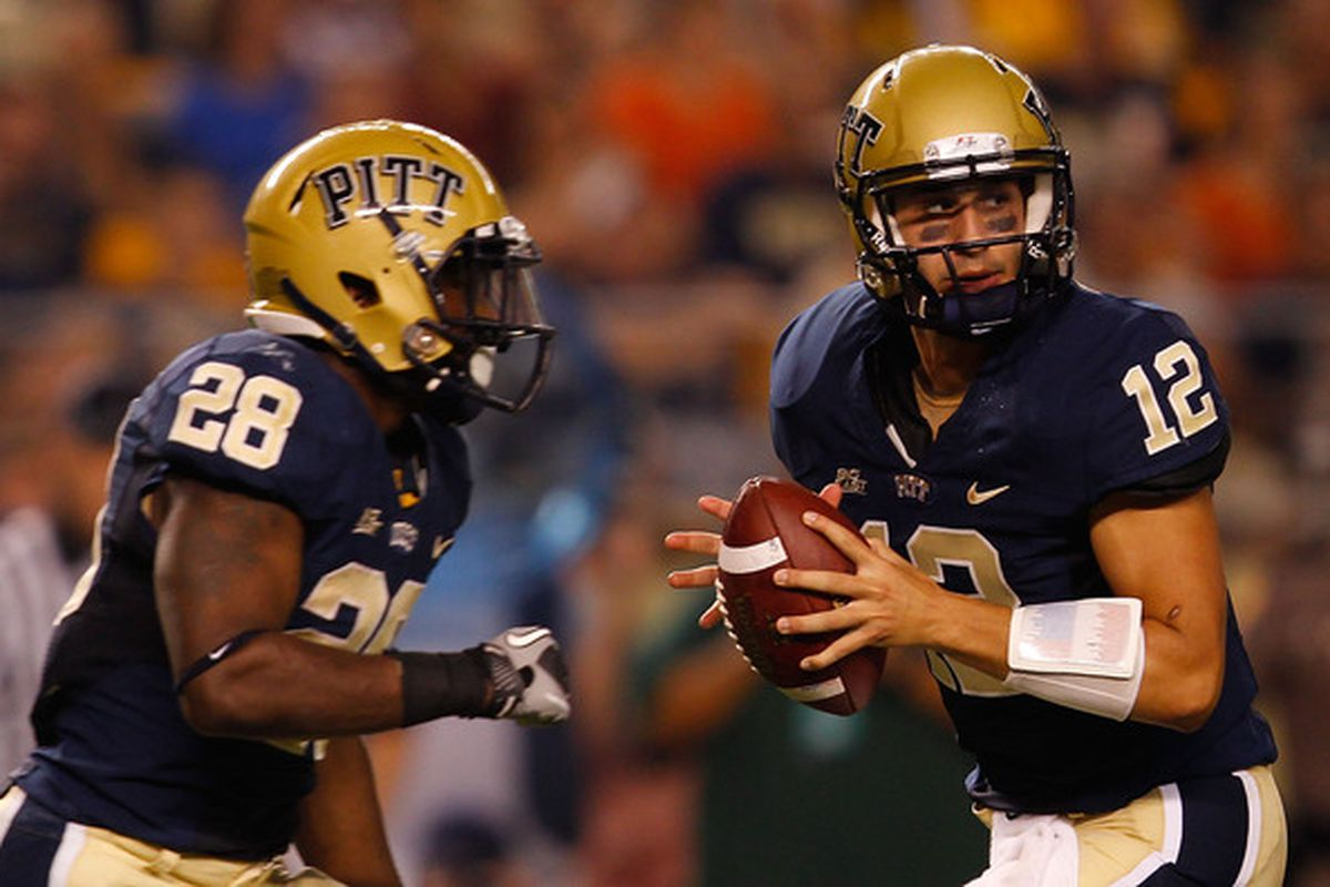 PITTSBURGH - SEPTEMBER 23:  Tino Sunseri #12 of the Pittsburgh Panthers drops back to pass in front of teammate Dion Lewis #28 (Photo by Jared Wickerham/Getty Images)