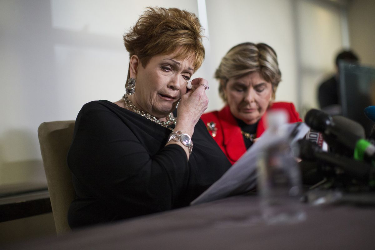 Attorney Gloria Allred (R) looks on as Beverly Young Nelson tears up during  a press conference on November 13. Nelson alleges that Roy Moore sexually  ...