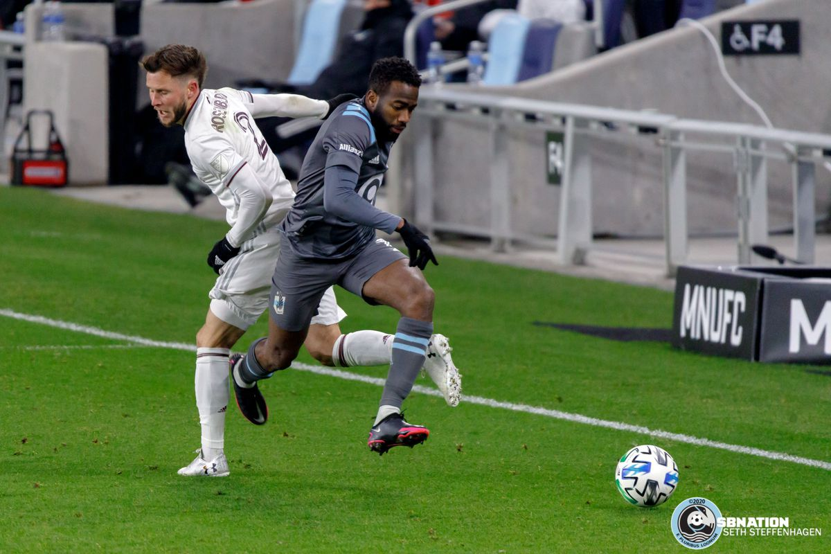 November 22, 2020 - Saint Paul, Minnesota, United States - Minnesota United midfielder Kevin Molino (7) gets by Colorado Rapids defender Keegan Rosenberry (2) during the first round playoff match at Allianz Field.