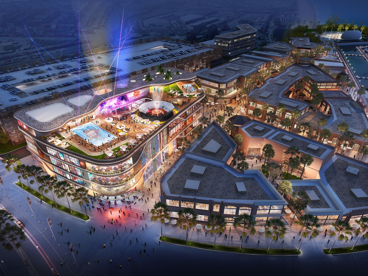 A rendering of Queen Mary Island, seen from the air above. The dynamic entertainment zone is lit up at night.