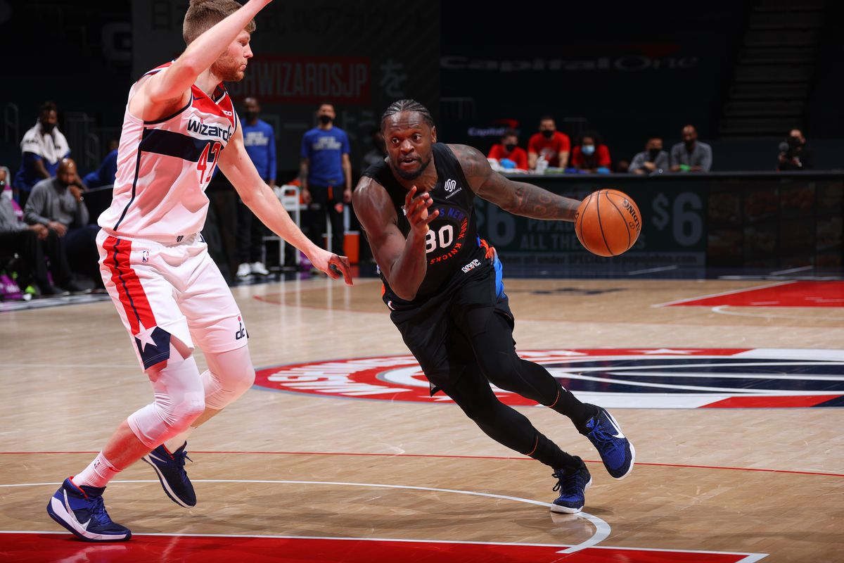 Julius Randle #30 of the New York Knicks drives to the basket during the game against the Washington Wizards on February 12, 2021 at Capital One Arena in Washington, DC.
