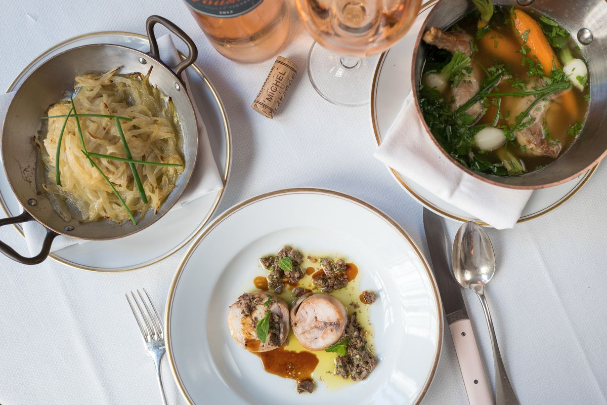 A spread of dishes at Le Coucou