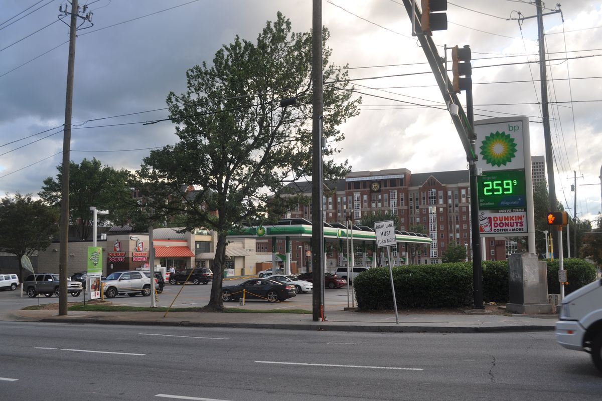 The one-story mini mart and gas pumps from across the street.