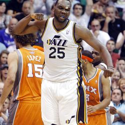 Utah Jazz center Al Jefferson (25) celebrates a shot in the fourth quarter as the Utah Jazz and the Phoenix Suns play Tuesday, April 24, 2012 in Energy Solutions arena. Utah won 100-88.