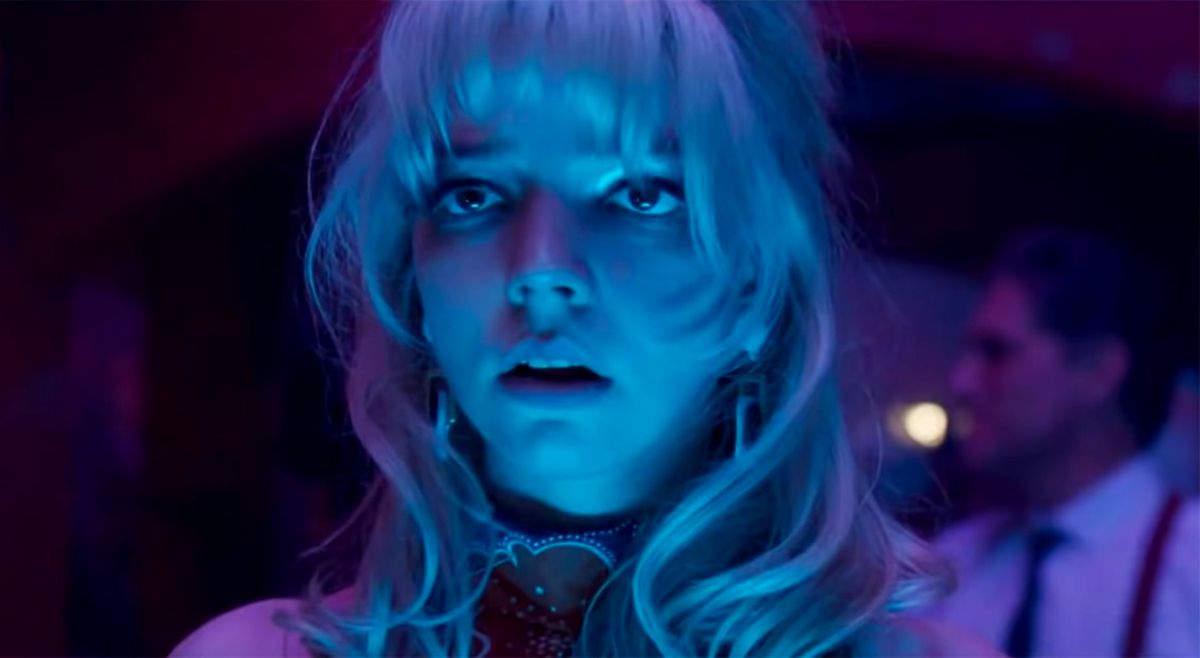 Anya Taylor-Joy, lit in neon blue and terrified, in Last Night in Soho