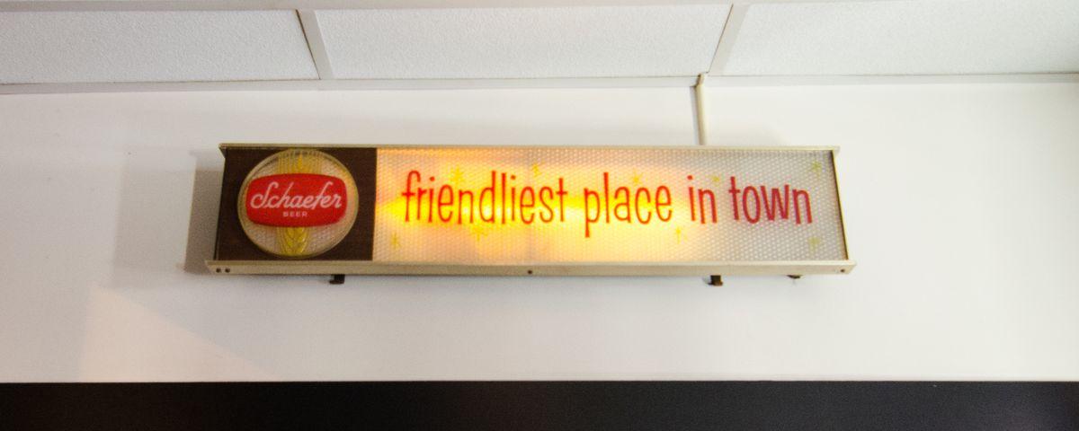 "Vintage restaurant signage reads ""friendliest place in town"""