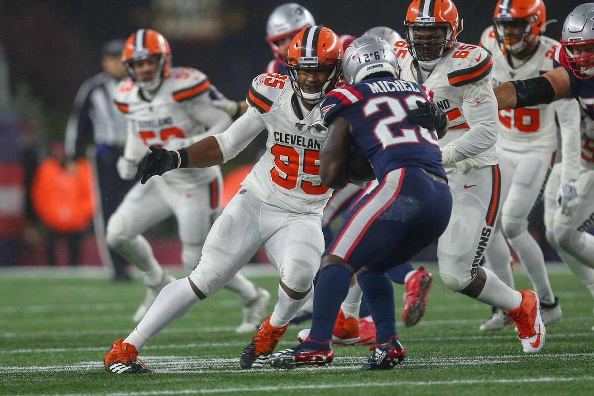 New England Patriots running back Sony Michel is tackled by Cleveland Browns defensive end Myles Garrett during the fourth quarter at Gillette Stadium.