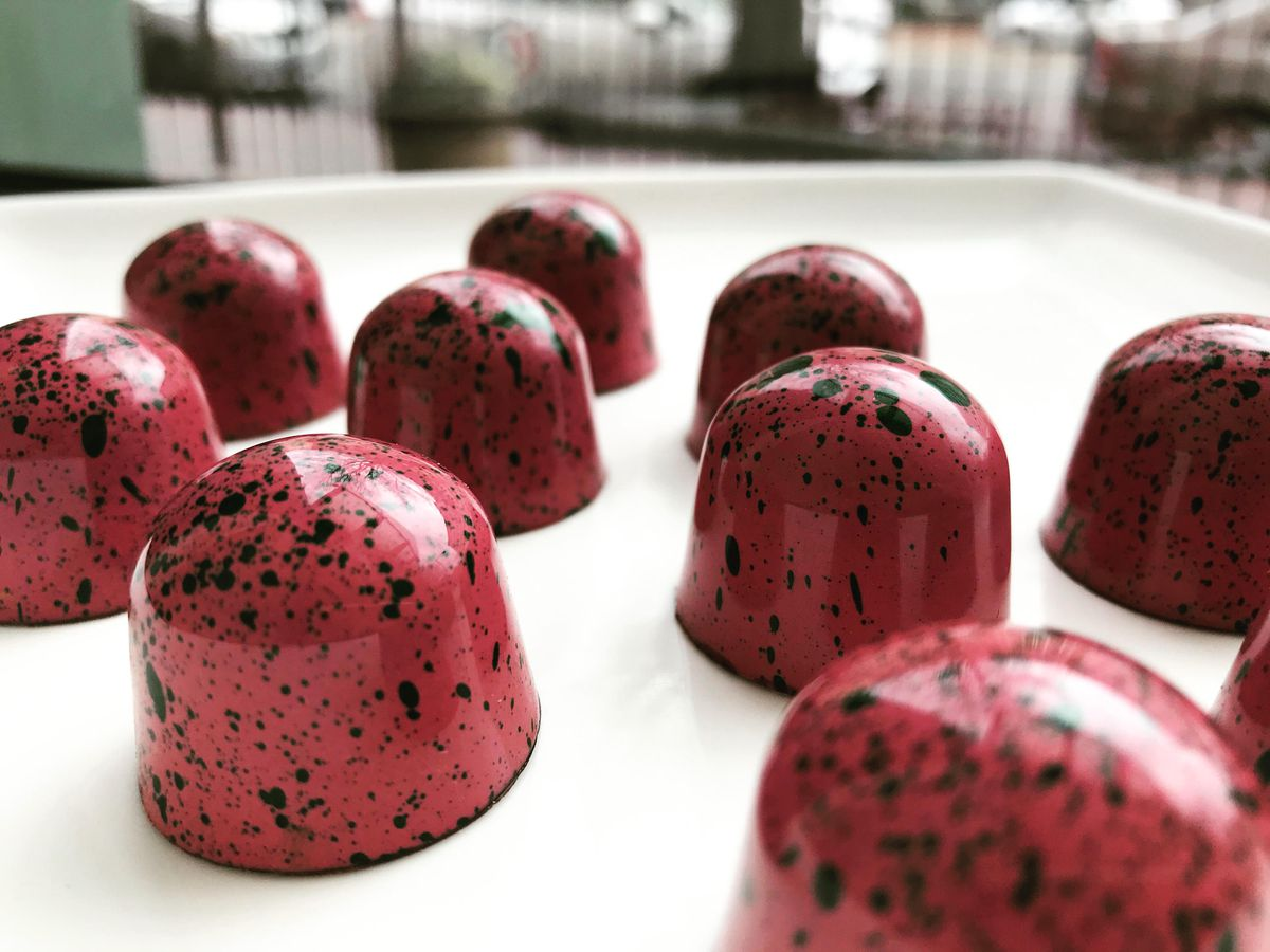 Bonbons from Petite Soeur are covered in a glossy coat of dark pink with flecks of black