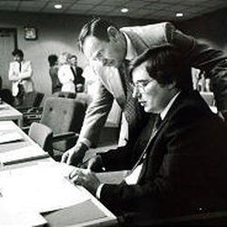 Mark Hofmann with his father, William, during a preliminary hearing in April 1986. The killer's doctored documents continue to surface.