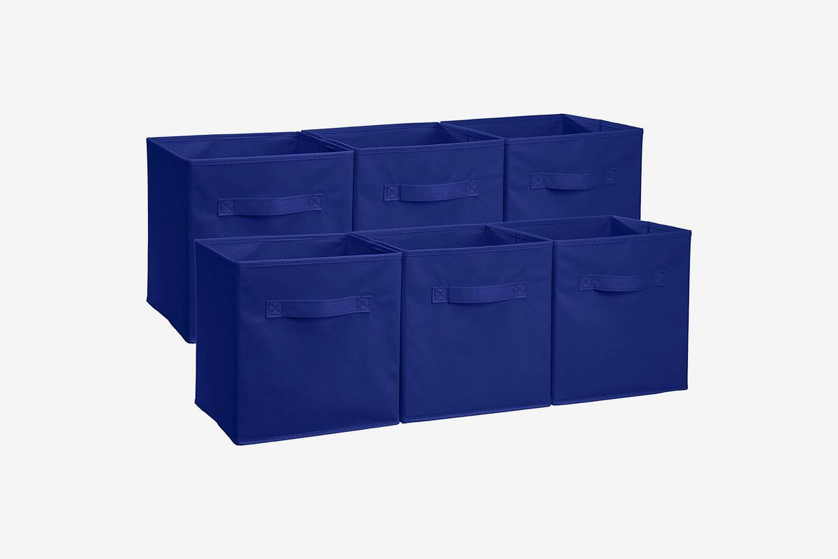Multiple blue fabric storage boxes.