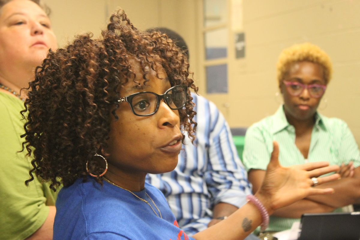 Northaven school librarian Judy Walker offers input during her small group gathering.