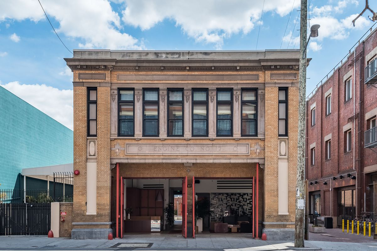 A historic firehouse building that has been converted to a boutique hotel, as seen from the outside.