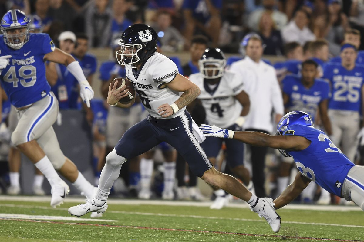 Air Force's Demonte Meeks misses a tackle on the Utah State quarterback Andrew Peasley during an NCAA college football game Saturday, Sept. 18, 2021, at Air Force Academy, Colo.
