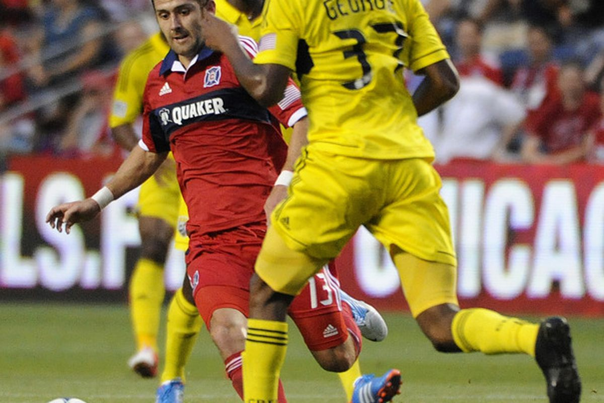 BRIDGEVIEW, IL - JUNE 23:  Gonzalo Segares #13 of the Chicago Fire and Kevan George #37 of the Columbus Crew battle for the ball in an MLS match on June 23, 2012 at Toyota Park in Bridgeview, Illinois.   (Photo by David Banks/Getty Images)