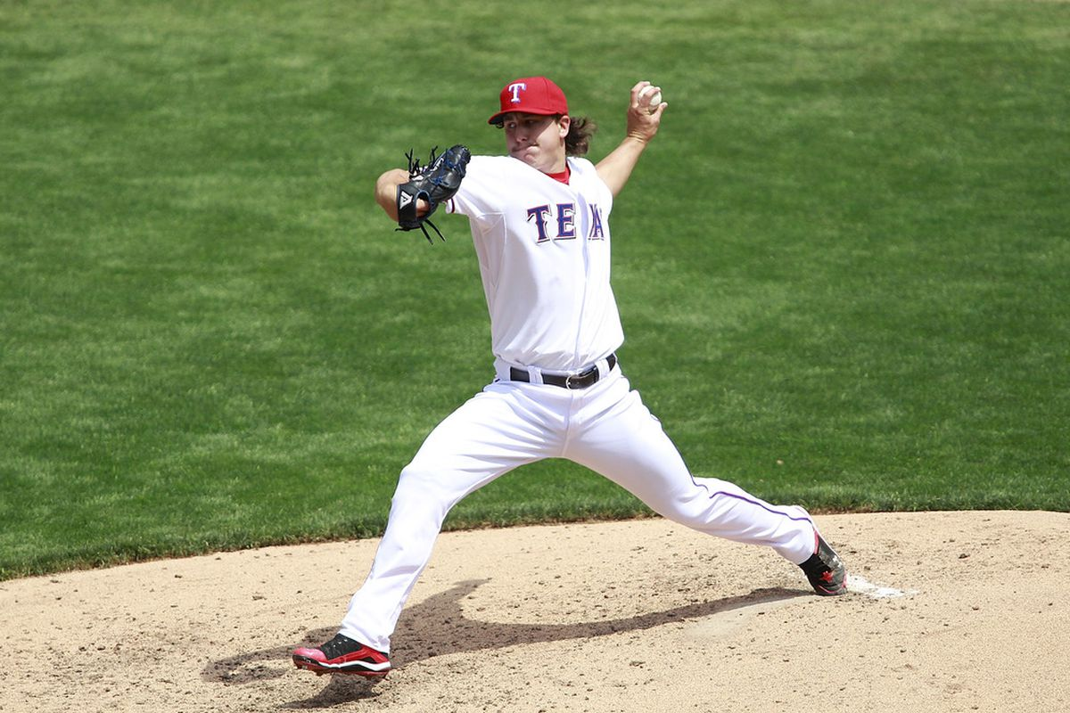 ARLINGTON, TX - APRIL 12:  Derek Holland #45 of the Texas Rangers delivers a pitch against the Seattle Mariners at Rangers Ballpark in Arlington on April 12, 2012 in Arlington, Texas. (Photo by Rick Yeatts/Getty Images)