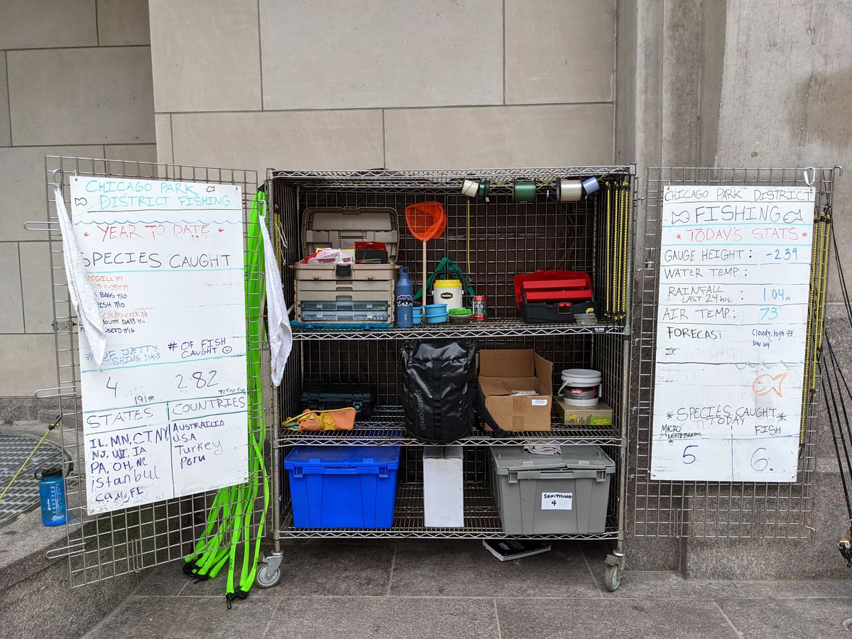 """The working cart for """"Fishing at the Jetty"""" program on the Chicago Riverwalk includes boards with updated fishing and water data. Credit: Dale Bowman"""