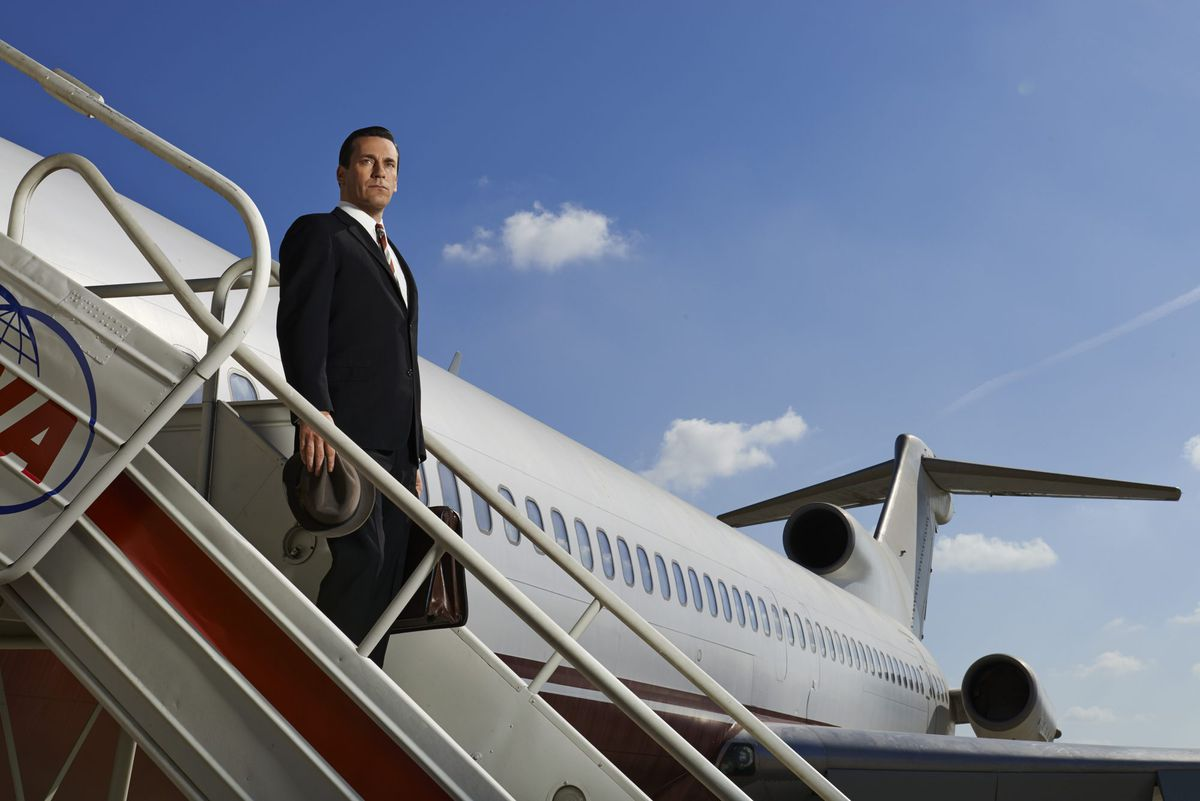 Don Draper stands on the staircase to a jet in Mad Men season 6 promotional art