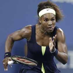 Serena Williams, of the United States, chases down a shot from Ana Ivanovic, of Serbia, during a quarterfinal at the U.S. Open tennis tournament Wednesday, Sept. 5, 2012, in New York. (AP Photo/Darron Cummings)