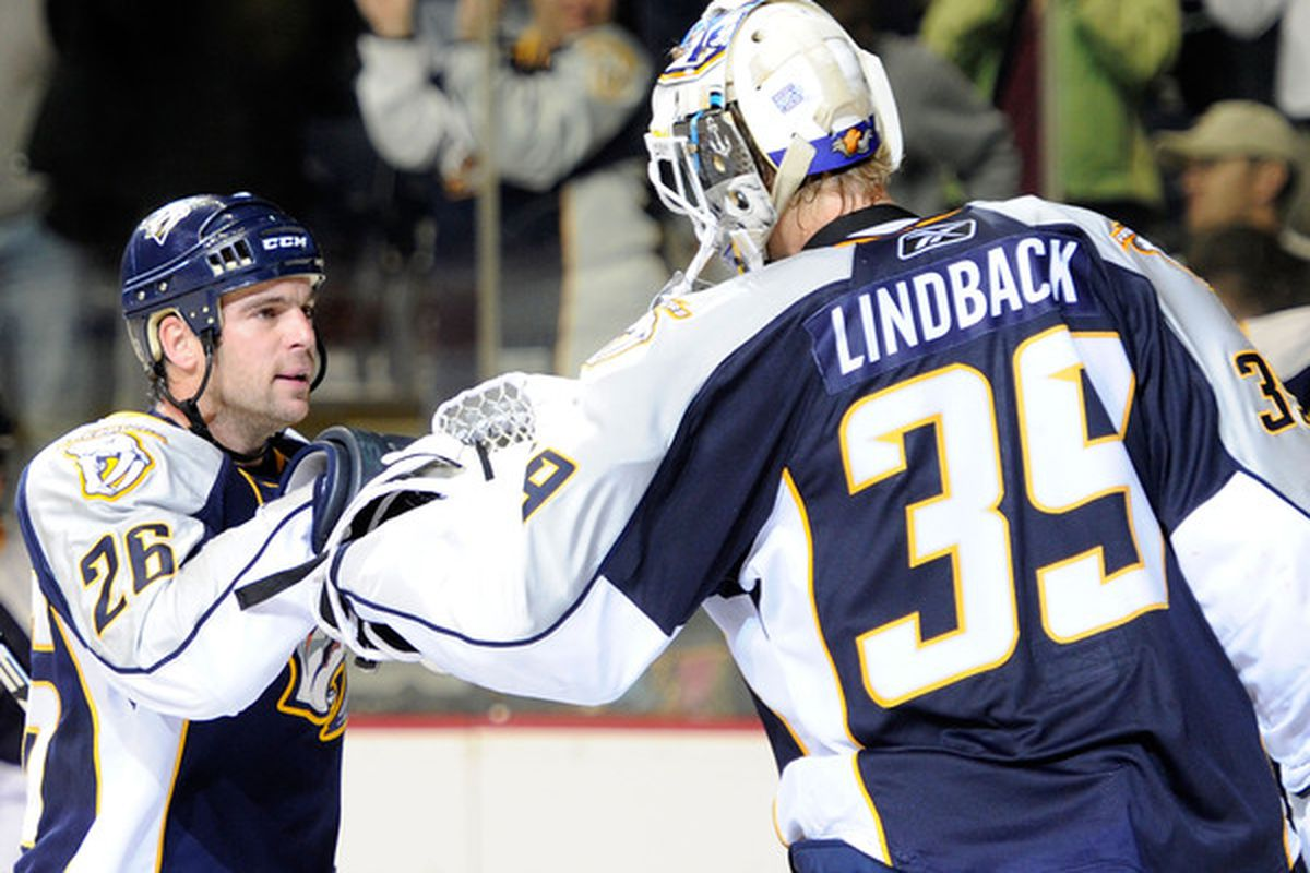 NASHVILLE TN - OCTOBER 14:  Right wing Steve Sullivan #26 of the Nashville Predators congratulates teammate Anders Lindback #39 after defeating the St. Louis Blues on October 14 2010 in Nashville Tennessee.  (Photo by Frederick Breedon/Getty Images)