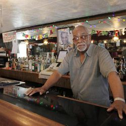 In this April 17, 2012, photo, Homer Wright poses for a photo in his bar in the Englewood neighborhood of Chicago. Wright was arrested after he shot a man allegedly trying to break into his home, with authorities later dropping the charges. Wright says he needs a gun to protect himself and his tavern in Chicago's Englewood neighborhood. When the trial of William Balfour begins Monday, April 23 for the 2008 killings of three of singer and Oscar winner Jennifer Hudson's family it will be an all-too-familiar story of death and violence in Englewood on the city's South Side.