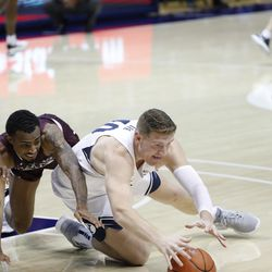 BYU forward Kolby Lee (40) dives to the floor for a loose ball during the Cougars' 87-71 victory over Texas Southern at the Marriott Center in Provo on Monday, Dec. 21, 2020.
