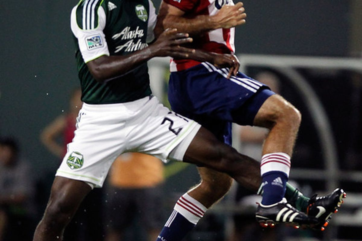PORTLAND, OR - AUGUST 24:  Diego Charra #21 of the Portland Timbers goes for a header against Nick LaBrocca #10 of Chivas USA  on August 24, 2011 at Jeld-Wen Field in Portland, Oregon.  (Photo by Jonathan Ferrey/Getty Images)
