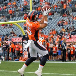 Broncos WR River Cracraft hauls in a pass over the shoulder during pregame warmups.