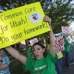 Lynda Roper, joins with other protesters demonstrating Friday, Aug. 8, 2014, prior to the Utah Board of Education's vote on whether to request an extended waiver from the Adequate Yearly Progress requirements of No Child Left Behind.