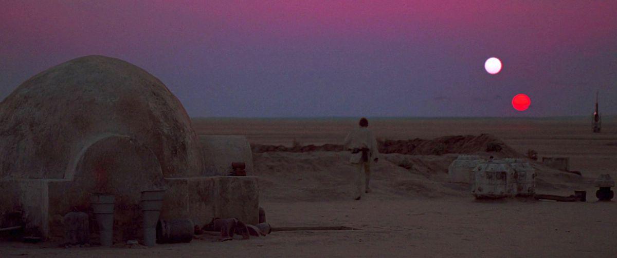 Luke Skywalker walking toward the two-sun sunset on Tatooine in Star Wars: A New Hope