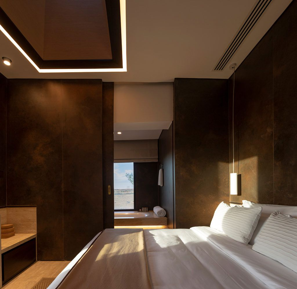 Bed in room with dark walls