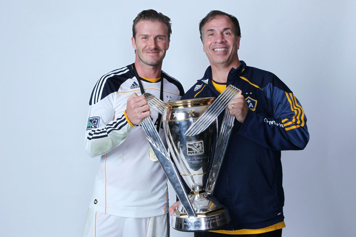 CARSON, CA - NOVEMBER 20:  (L-R) David Beckham #23 and Bruce Arena of the Los Angeles Galaxy pose for a portrait following the 2011 MLS Cup at The Home Depot Center on November 20, 2011 in Carson, California.  (Photo by Jeff Gross/Getty Images)